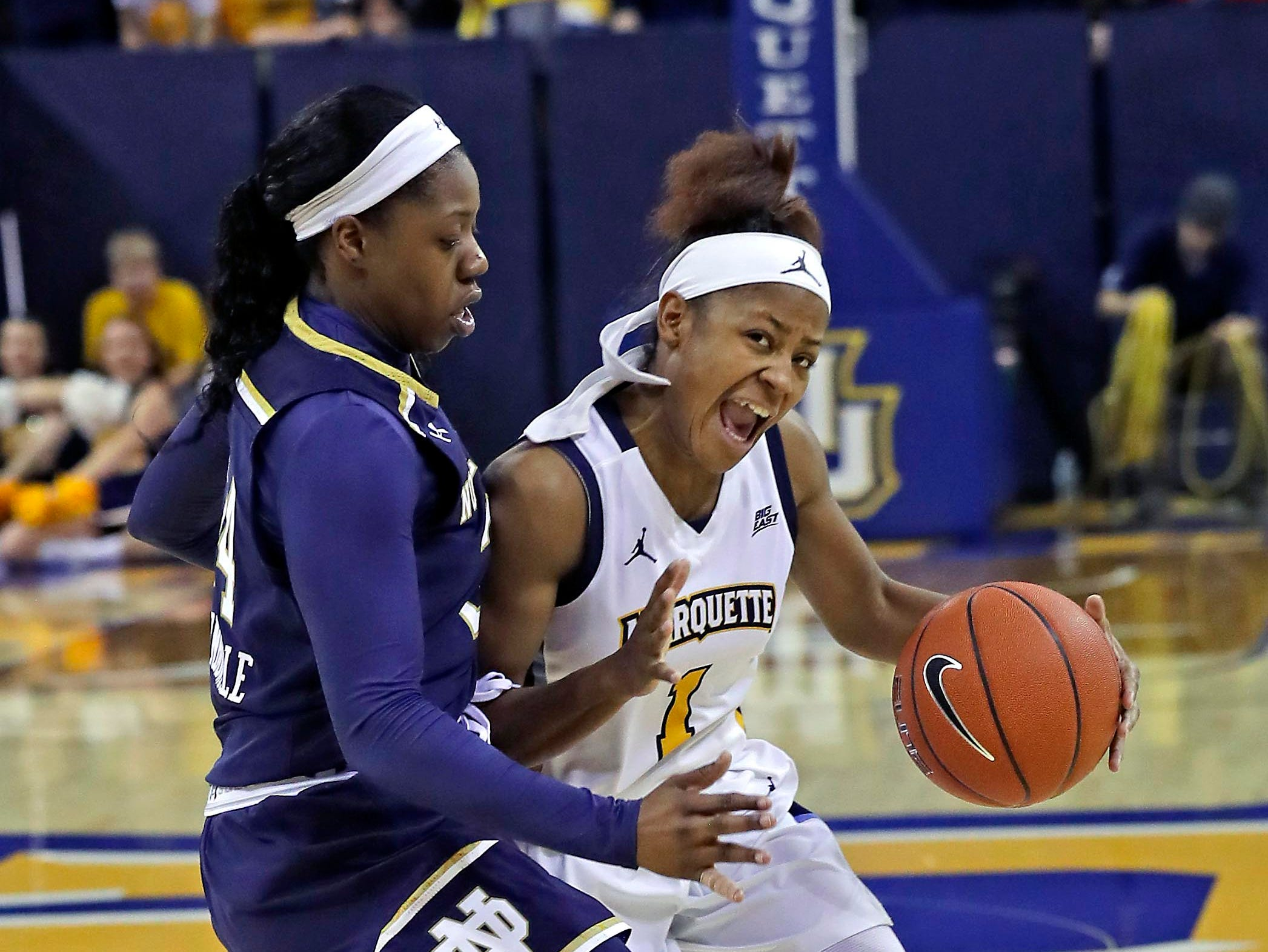 Marquette Golden Eagles guard Danielle King (1) is pressed hard by Notre Dame Fighting Irish guard Arike Ogunbowale during a women's basketball  game  between Marquette and Notre Dame. Defending national champion Notre Dame, which won the game, 87-63, is led by Ogunbowale, a former DSHA star.