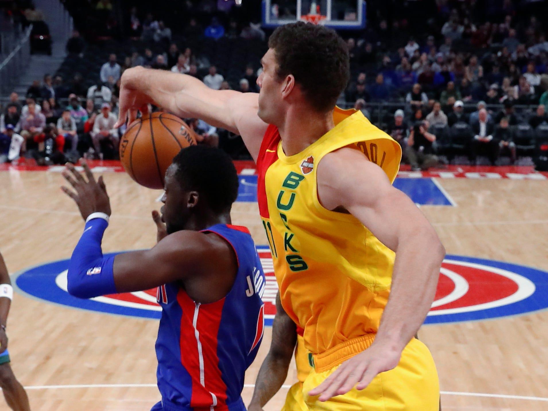 Bucks center Brook Lopez blocks a shot by Pistons guard Reggie Jackson on Tuesday night.