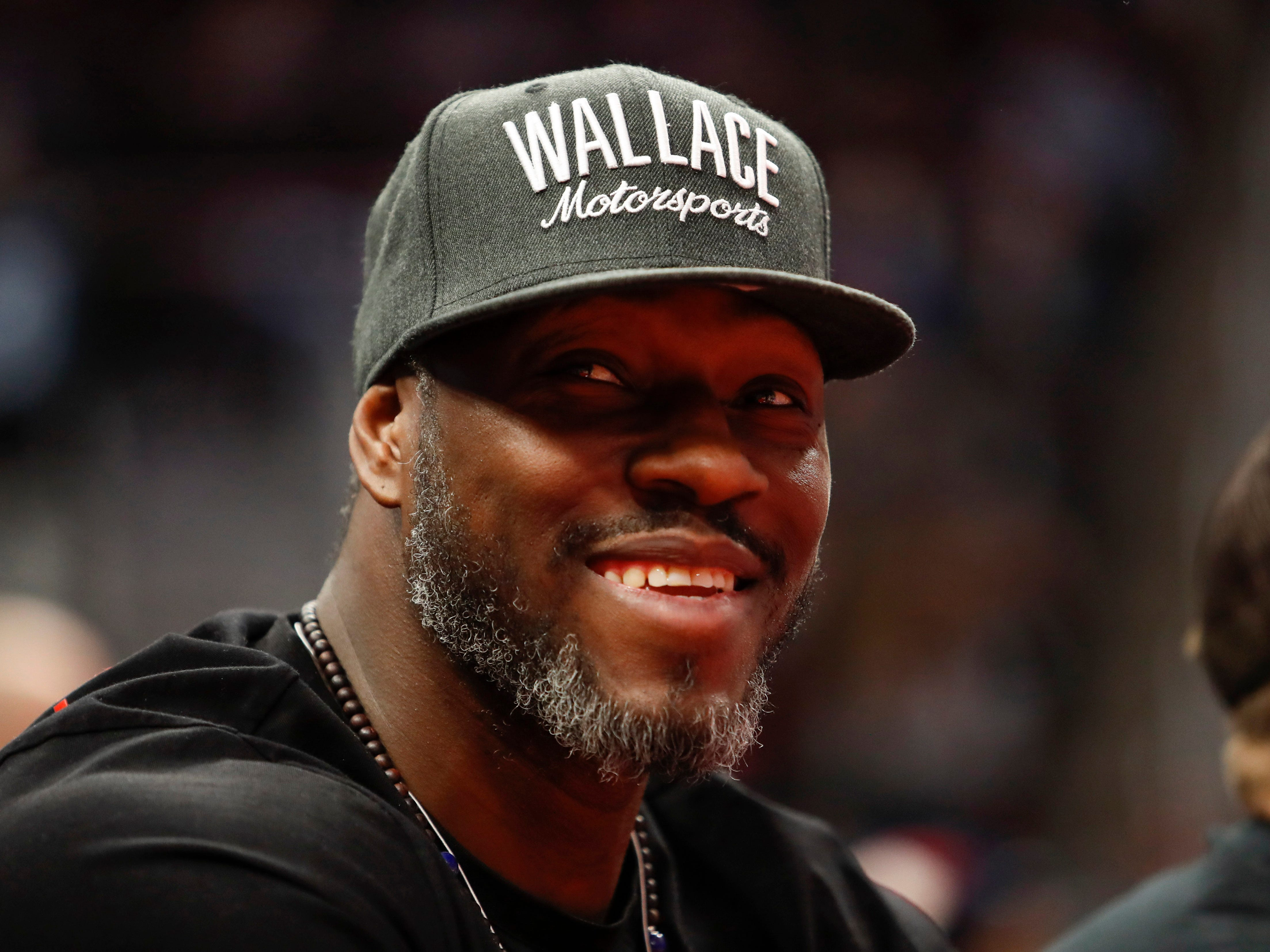 Former Piston  Ben Wallace watches the game on tuesday night.