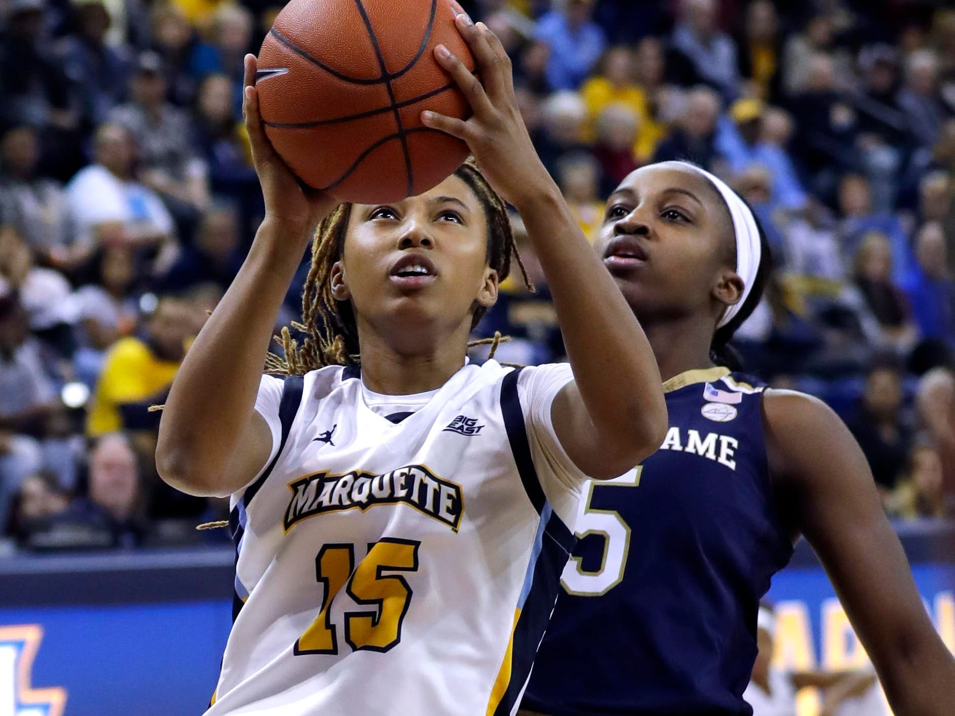 Marquette Golden Eagles guard Amani Wilborn (15) gets past Notre Dame Fighting Irish guard Jackie Young (5) for a score during the women's basketball  game  between Marquette and Notre Dame. Notre Dame, the the defending national champion, which won the game 87-63, is led by former DSHA star Arike Ogunbowale. MU is also a top-25 team expected to win the Big East.   MILWAUKEE JOURNAL SENTINEL/RICK WOOD ORG XMIT: 20097356A