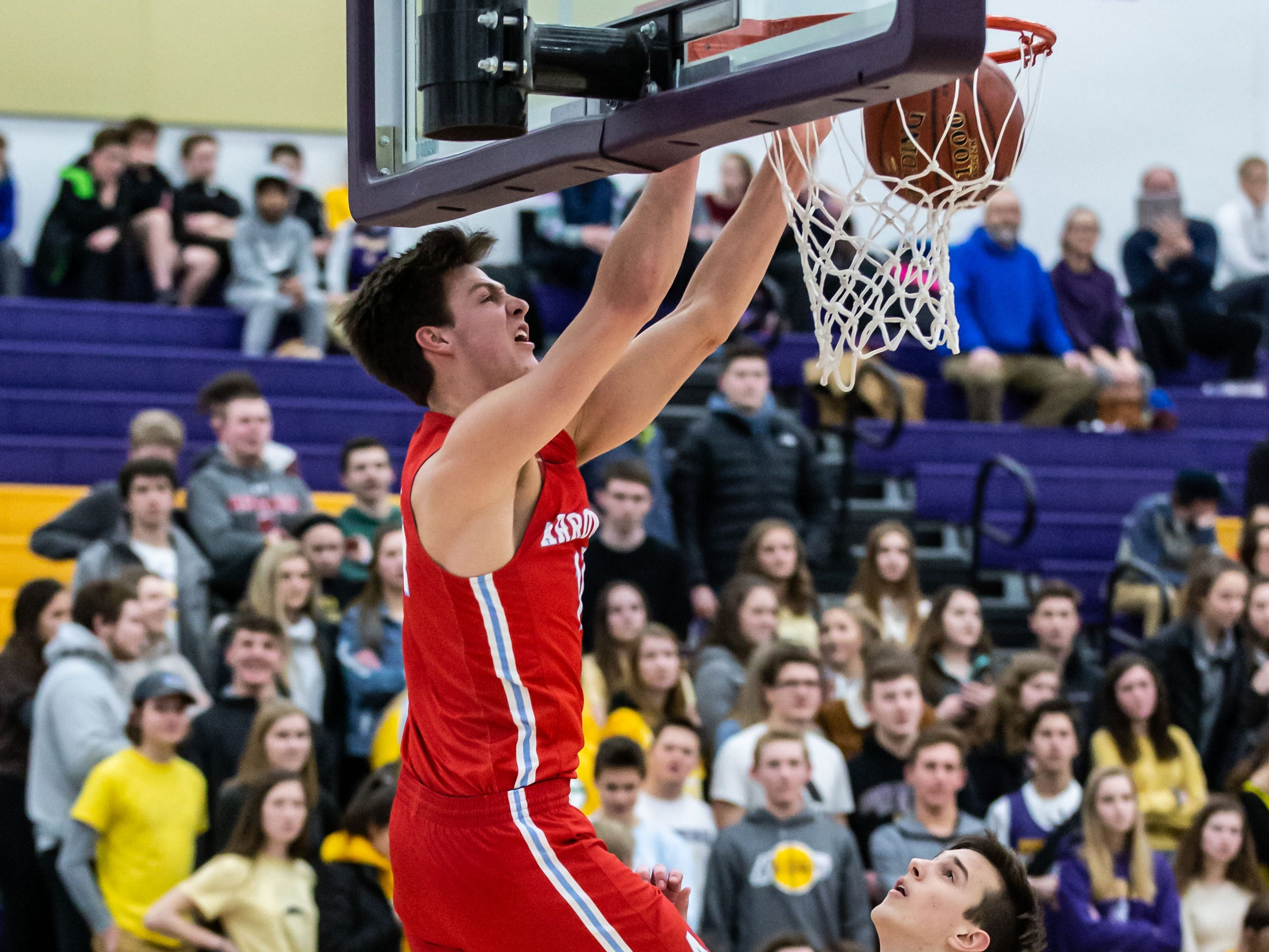Arrowhead's Carter Gilmore (14) elevates for a slam dunk over Oconomowoc's Ray Lestina during the game at Oconomowoc on Tuesday, Jan. 29, 2019. The dunk did not count as a whistle had been blown.
