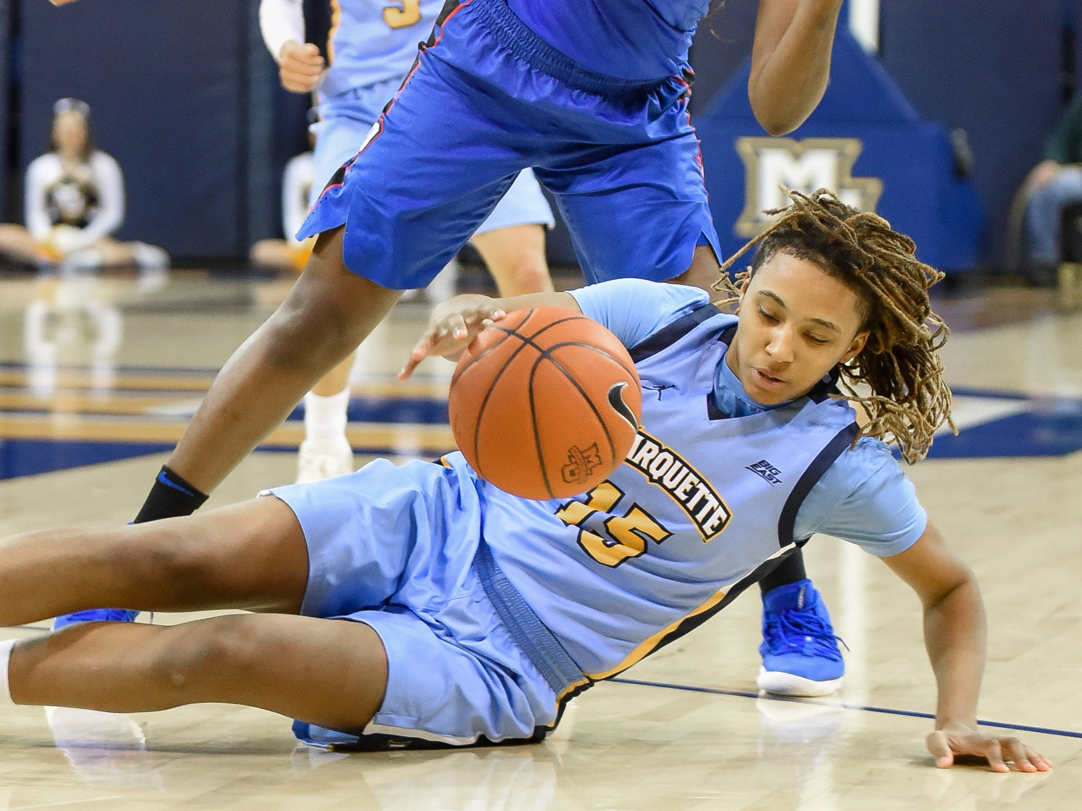 Marquette guard Amani Wilborn beats DePaul guard Ashton Millender to the ball and draws a foul in a Big East Conference women's basketball game Friday, January 4, 2019, at the Al McGuire Center on the Marquette campus.