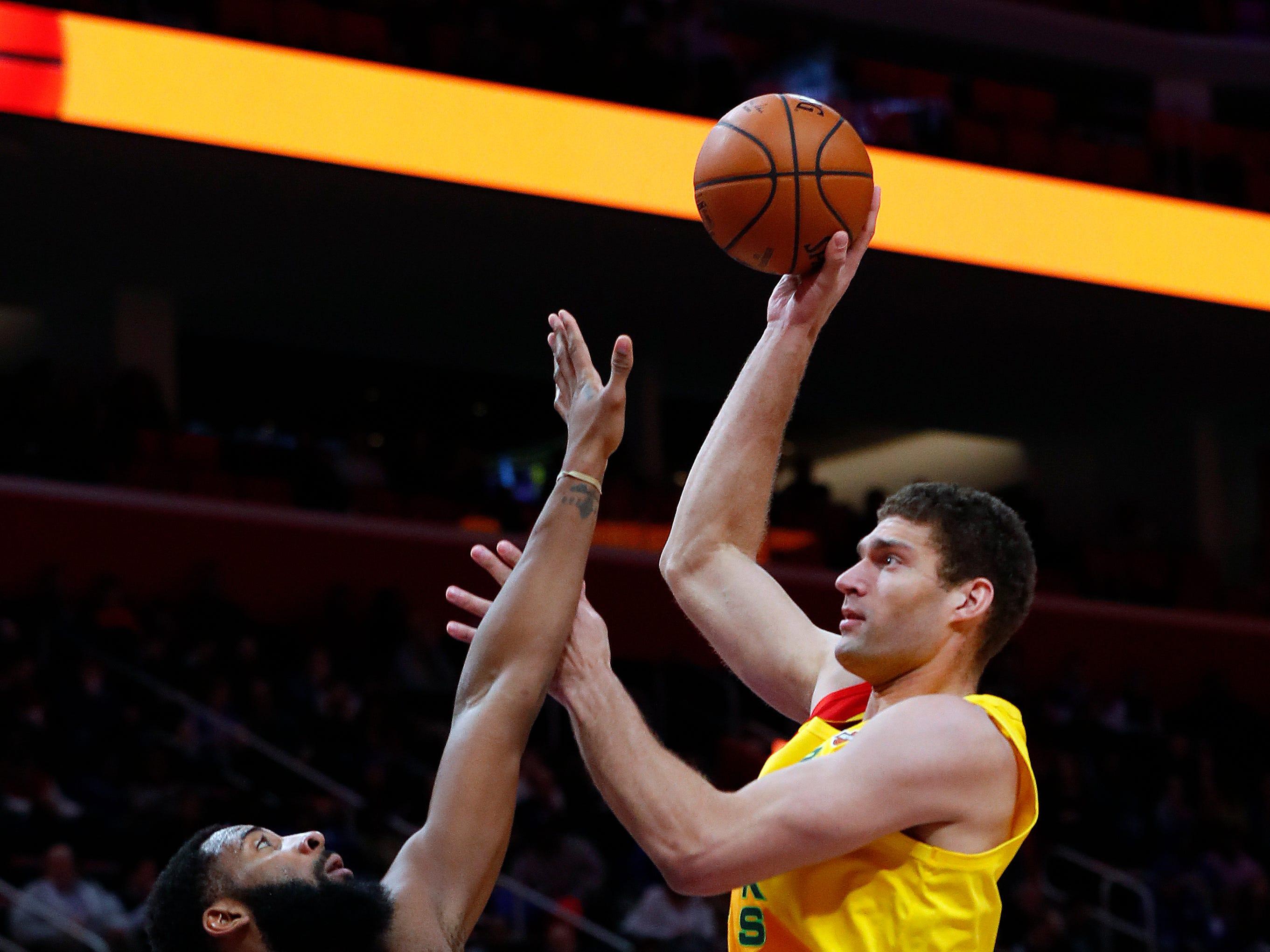 Bucks center Brook Lopez  shoots over  Pistons center Andre Drummond.