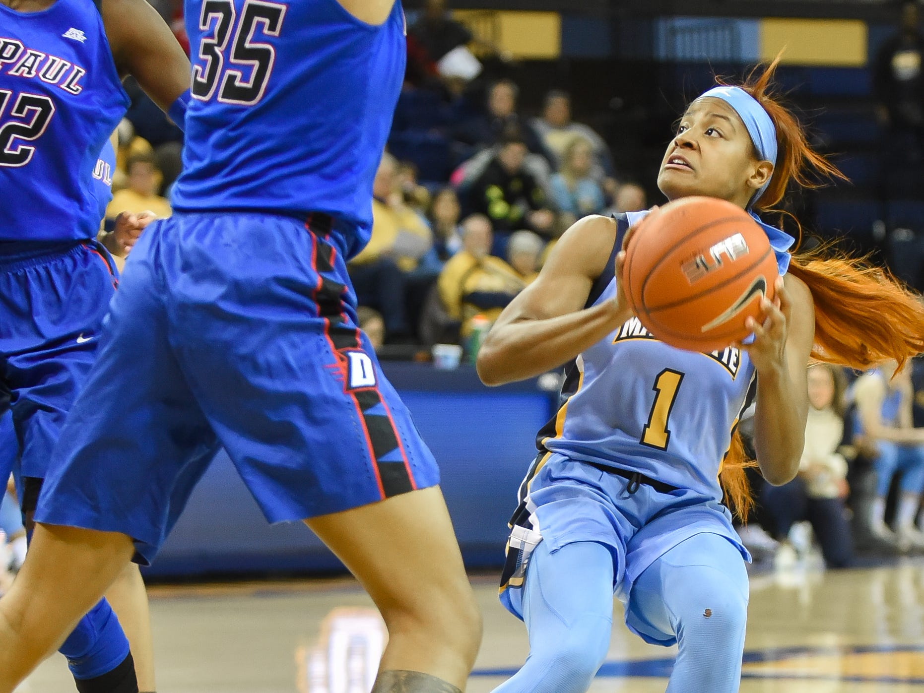 Marquette guard Danielle King eyes a shot over DePaul forward Mart'e Grays in a Big East Conference women's basketball game Friday, January 4, 2019, at the Al McGuire Center on the Marquette campus.