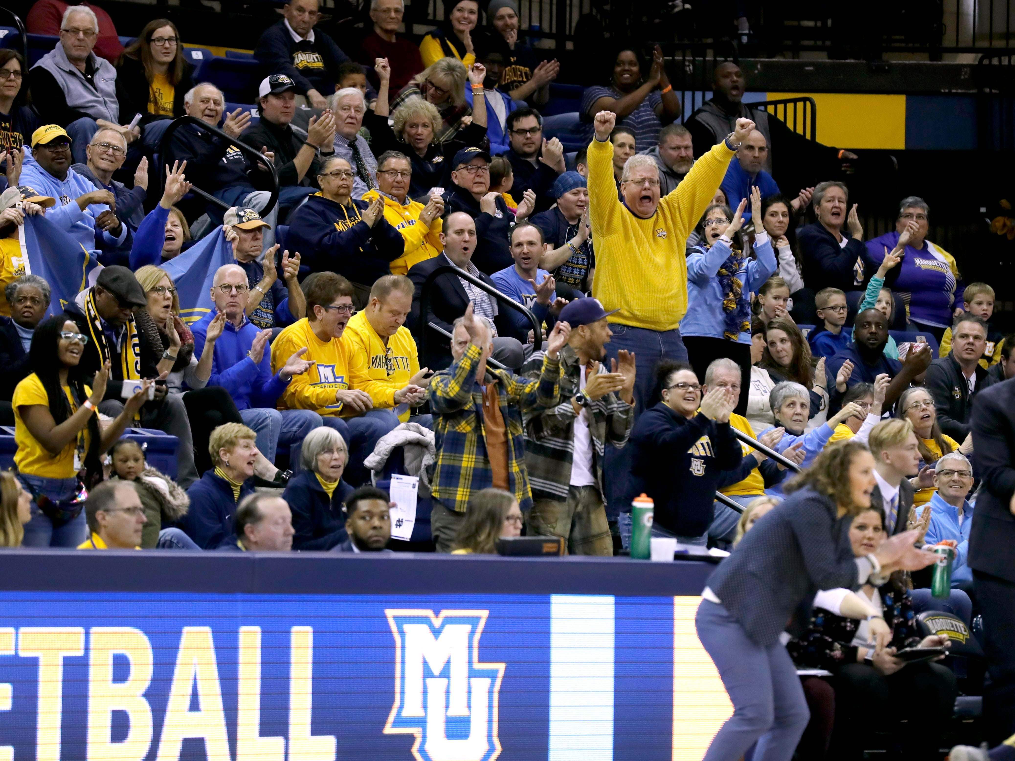 Fans cheer a three-point shot by Marquette Golden Eagles guard Natisha Hiedeman (5) during the women's basketball  game  between Marquette and Notre Dame. Notre Dame, the the defending national champion, which won the game 87-63, is led by former DSHA star Arike Ogunbowale. MU is also a top-25 team expected to win the Big East.   MILWAUKEE JOURNAL SENTINEL/RICK WOOD ORG XMIT: 20097356A