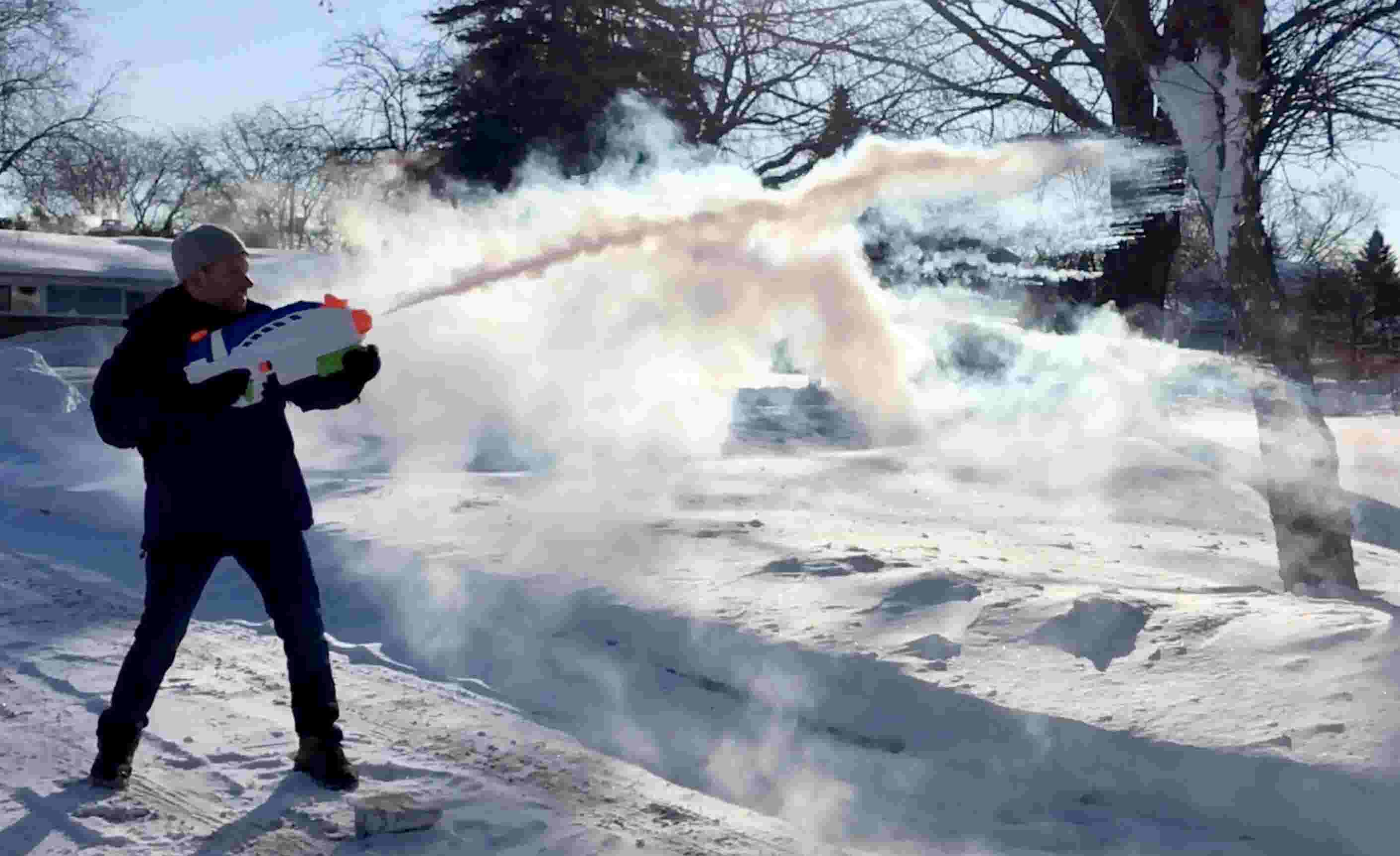 Watch what boiling water looks in the cold tossed in the air and shot from  a Super Soaker