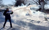 Journal Sentinel photographer Mike De Sisti demonstrates how boiling water reacts to the cold when tossed in the air and shot through a Super Soaker.