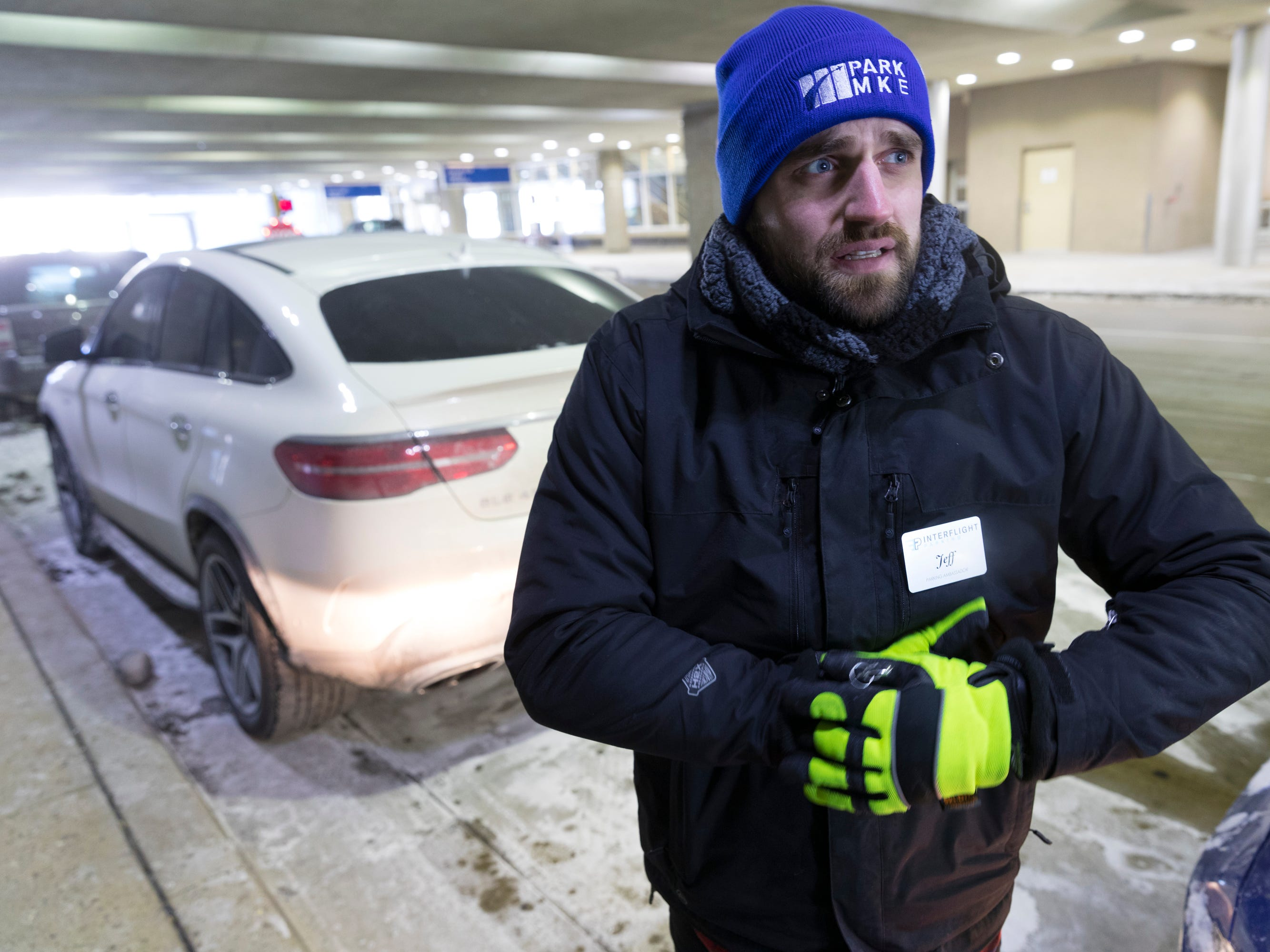 Jeff Plewa, an employee of Interflight Parking, works at the valet parking drop-off/pickup location at Mitchell Airport in Milwaukee. Besides parking and retrieving customers' cars, he also jump-starts cars in the airport ramp and parking lots.