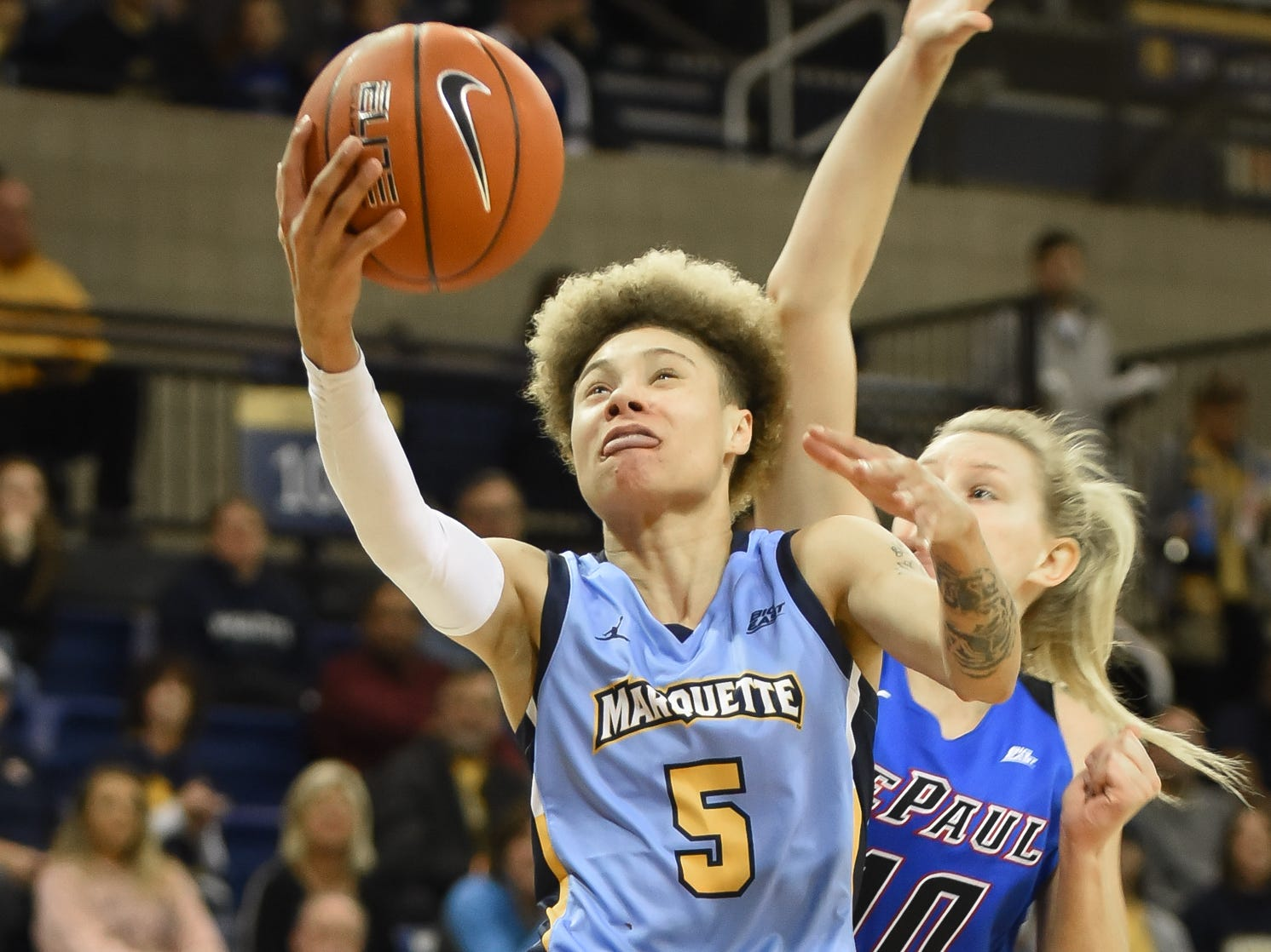 Marquette guard Natisha Hiedeman beats DePaul guard Lexi Held for a layup in a Big East Conference women's basketball game Friday, January 4, 2019, at the Al McGuire Center on the Marquette campus.