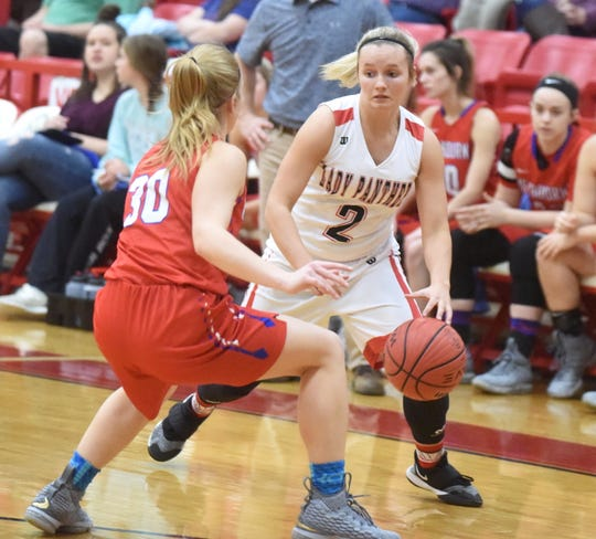 Norfork's Whitlee Layne (2) makes a move during a game earlier this season. Layne, who is third all-time on the state scoring list for 5-on-5 girls' basketball, passed her dad's career scoring mark of 3,316 on Tuesday night.