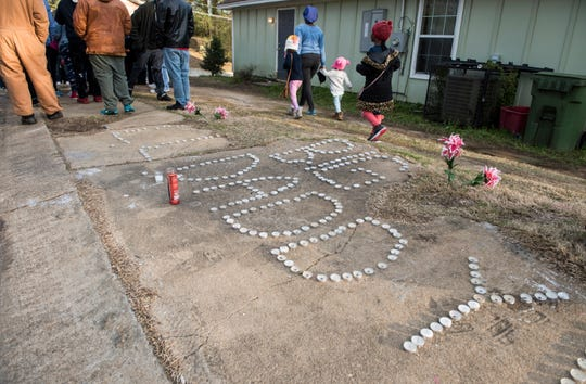 A candle light vigil in front of Jaylan Saunders home during a march against violence in Montgomery, Ala., on Tuesday, Jan. 29, 2019. Jaylan Saunders, 16, was shot and killed Jan. 24 at his home.