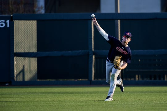Auburn right fielder Steven Williams makes a throw from right field during practice on Jan. 25, 2019.