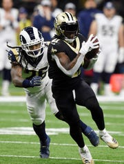 Jan 20, 2019; New Orleans, LA, USA; New Orleans Saints running back Alvin Kamara (41) runs the ball past Los Angeles Rams inside linebacker Mark Barron (26) during the first quarter in the NFC Championship game at Mercedes-Benz Superdome. Mandatory Credit: John David Mercer-USA TODAY Sports