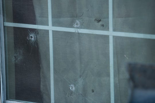 Bullet holes in the window of Jaylan Saunders home during a march against violence in Montgomery, Ala., on Tuesday, Jan. 29, 2019. Jaylan Saunders, 16, was shot and killed Jan. 24 at his home.