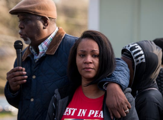 Bernadette Saunders looks on as Rev. Ken Austin speaks in front of the house her son was shot in last week during a march against violence in Montgomery, Ala., on Tuesday, Jan. 29, 2019. Jaylan Saunders, 16, was shot and killed Jan. 24 at his home.