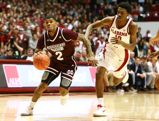 Jan 29, 2019; Tuscaloosa, AL, USA; Mississippi State Bulldogs guard Lamar Peters (2) dribbles the ball past Alabama Crimson Tide guard Herbert Jones (10) during the first half at Coleman Coliseum. Mandatory Credit: Marvin Gentry-USA TODAY Sports