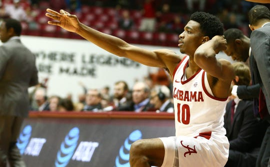 Jan 29, 2019; Tuscaloosa, AL, USA; Alabama Crimson Tide guard Herbert Jones (10) reacts after a three point basket by guard John Petty (not pictured) during the second half against the Mississippi State Bulldogs at Coleman Coliseum. Mandatory Credit: Marvin Gentry-USA TODAY Sports
