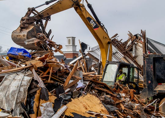 Debris from the Wetumpka First Presbyterian Church is cleared as the broken steeple of Wetumpka First Baptist Church is seen on Wednesday January 30, 2019. A tornado hit the town on Saturday January 19, 2019.
