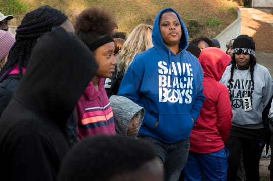 Kids gather for a prayer during a march against violence in Montgomery, Ala., on Tuesday, Jan. 29, 2019. Jaylan Saunders, 16, was shot and killed Jan. 24 at his home.