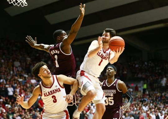 Jan 29, 2019; Tuscaloosa, AL, USA; Alabama Crimson Tide guard Riley Norris (1) shoots against Mississippi State Bulldogs forward Reggie Perry (1) during the second half at Coleman Coliseum. Mandatory Credit: Marvin Gentry-USA TODAY Sports