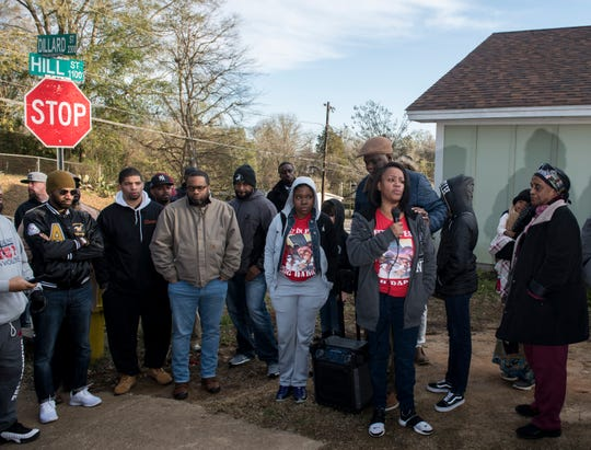 Bernadette Saunders speaks in front of the house her son was shot in last week during a march against violence in Montgomery, Ala., on Tuesday, Jan. 29, 2019. Jaylan Saunders, 16, was shot and killed Jan. 24 at his home.