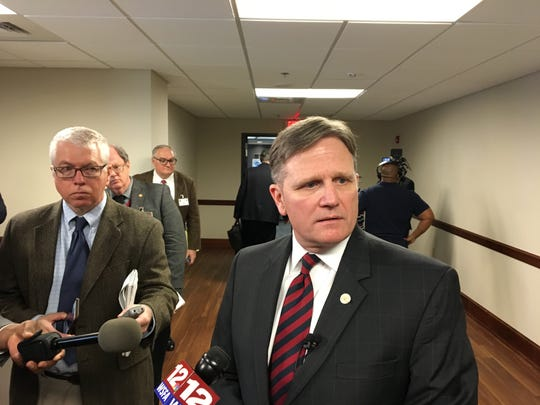 Alabama Department of Corrections Commissioner Jeff Dunn speaks to the media on January 30, 2019, after making his budget presentation to a meeting of the Alabama Legislature's budget committees.