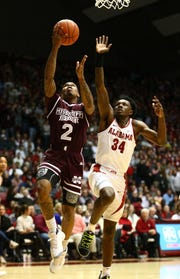 Jan 29, 2019; Tuscaloosa, AL, USA; Mississippi State Bulldogs guard Lamar Peters (2) shoots the ball past Alabama Crimson Tide guard Tevin Mack (34) during the first half at Coleman Coliseum. Mandatory Credit: Marvin Gentry-USA TODAY Sports