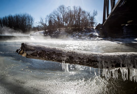 Icicles form near a dam on the White River near McCulloch Park Wednesday.