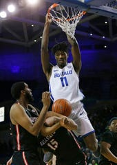 Buffalo forward Jeenathan Williams (11) dunks against Ball State during the first half of an NCAA college basketball game, Tuesday, Jan. 29, 2019, in Buffalo N.Y.