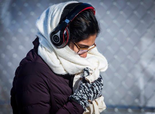 Pedestrians brave sub-zero temperatures near Ball State's campus Wednesday.