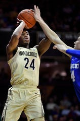 Vanderbilt forward Aaron Nesmith (24) shoots over Kentucky guard Tyler Herro (14) during the second half at Memorial Gym Tuesday Jan. 29, 2019 in Nashville, Tenn.