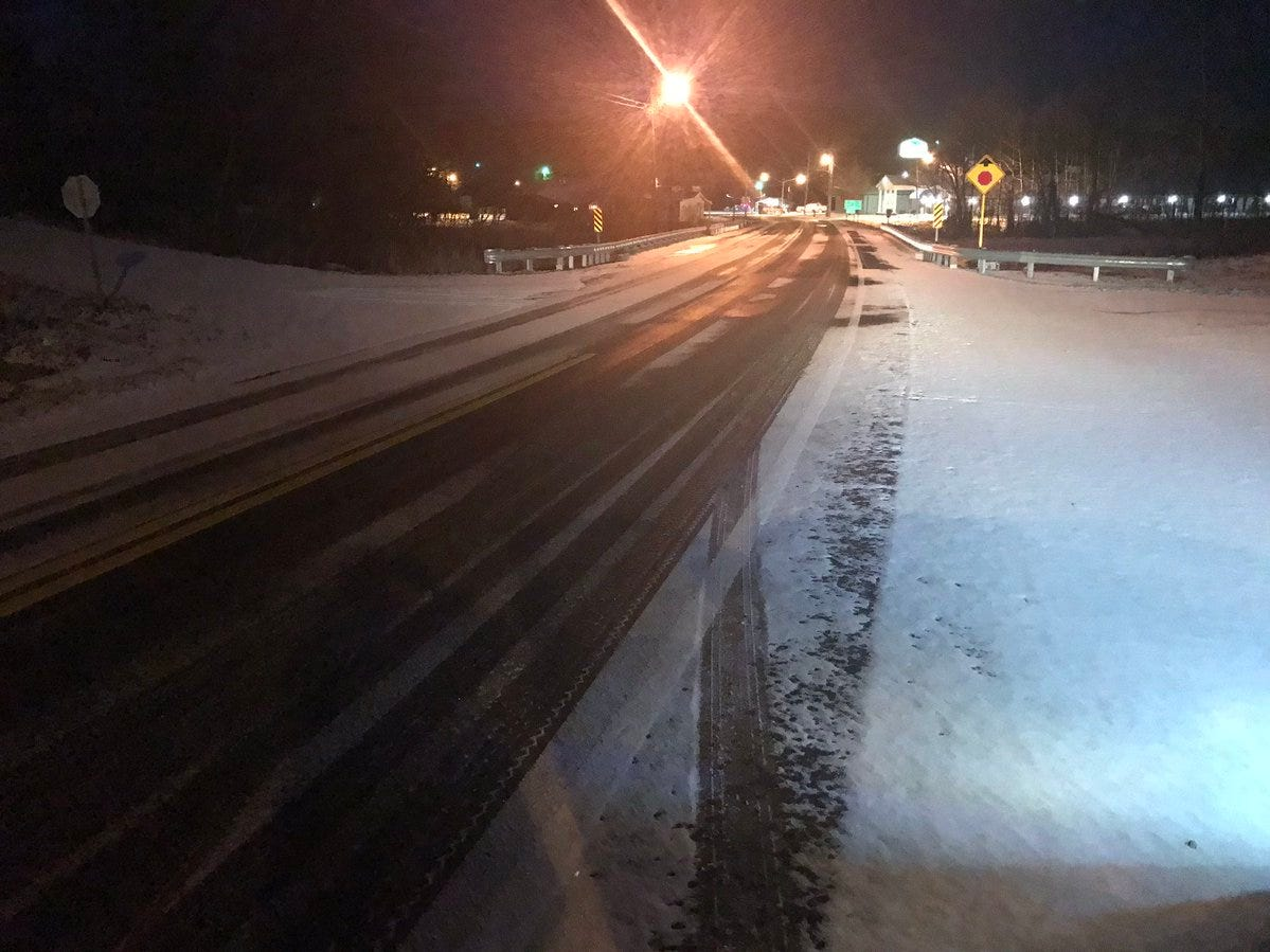 A dusting of snow blankets parts of State Road 31 in Houston County