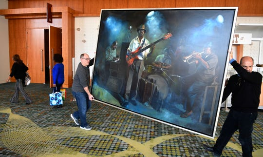 "David Reyes and Peter Baldaia prepare to transport ""True Blue"" by Jared Small to the Huntsville Museum of Art on Jan. 30 at Music City Center in Nashville. The artwork will be on loan until May."