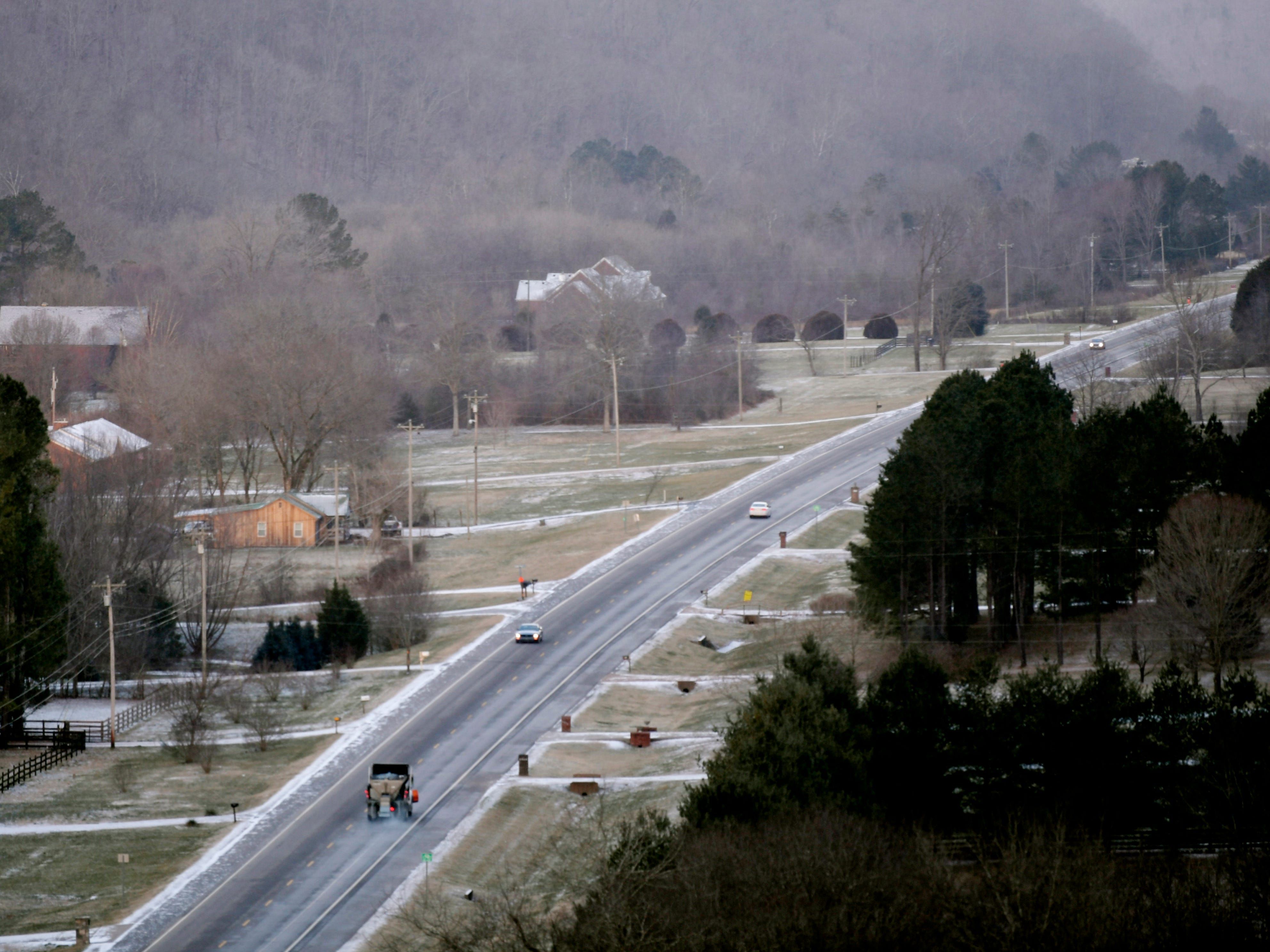 A view of Highway 96 as a snow plow moves down the road after a dusting of snow hit Middle Tennessee Wednesday, Jan. 30, 2018.