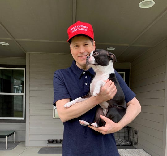 Ryan Moore with his MAGA hat and dog
