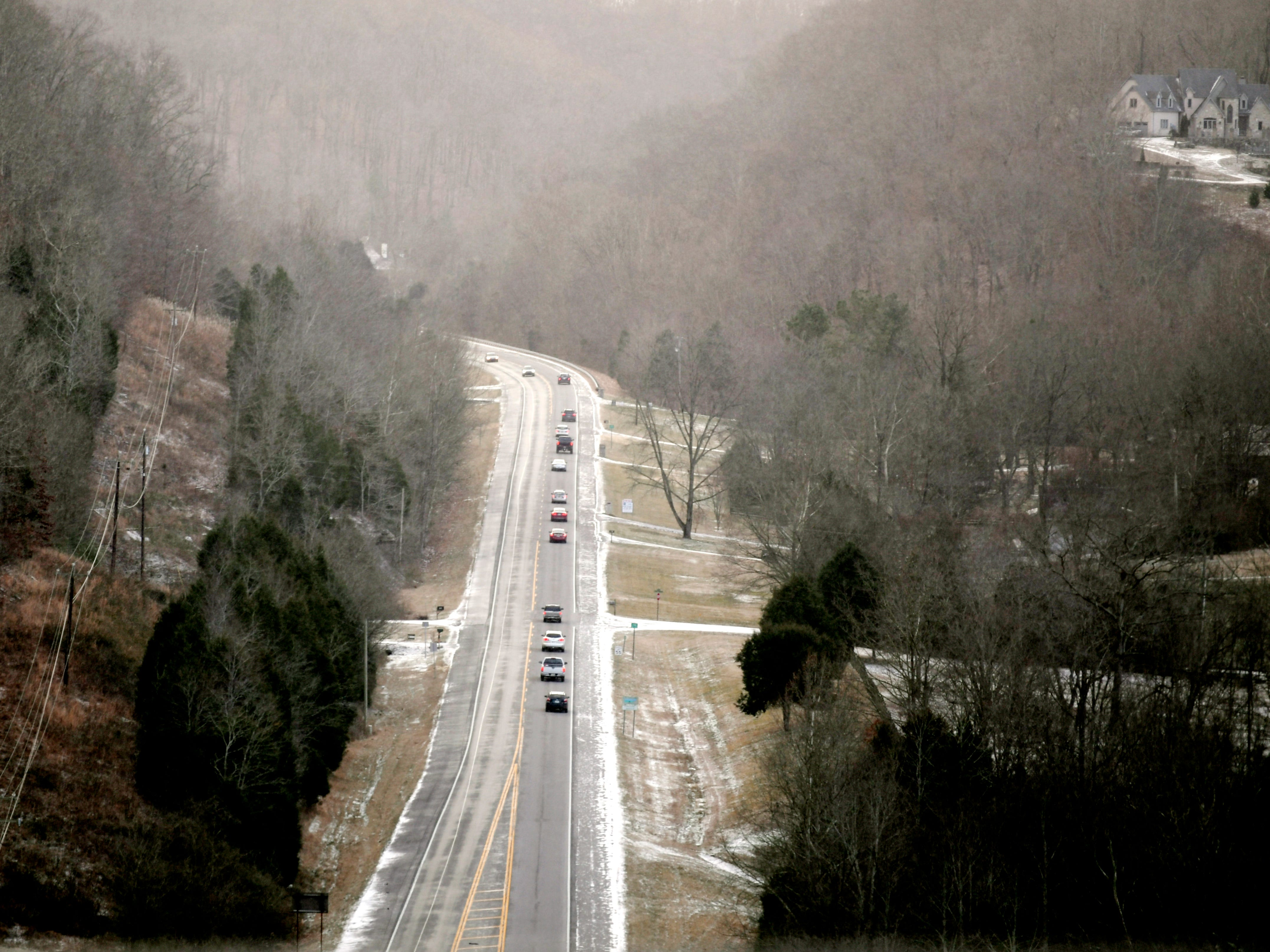 Cars travel on Highway 96 West near Natchez Trace Parkway after a dusting of snow hit Middle Tennessee Wednesday, Jan. 30, 2018.