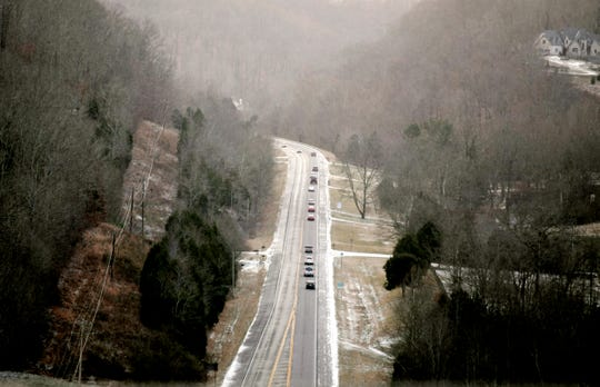 Cars travel on Highway 96 West near Natchez Trace Parkway after a dusting of snow hit Middle Tennessee on Wednesday.