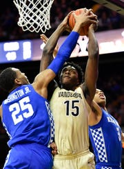 Vanderbilt forward Clevon Brown (15) is fouled by Kentucky forward PJ Washington (25) during the first half at Memorial Gym Tuesday Jan. 29, 2019 in Nashville, Tenn.