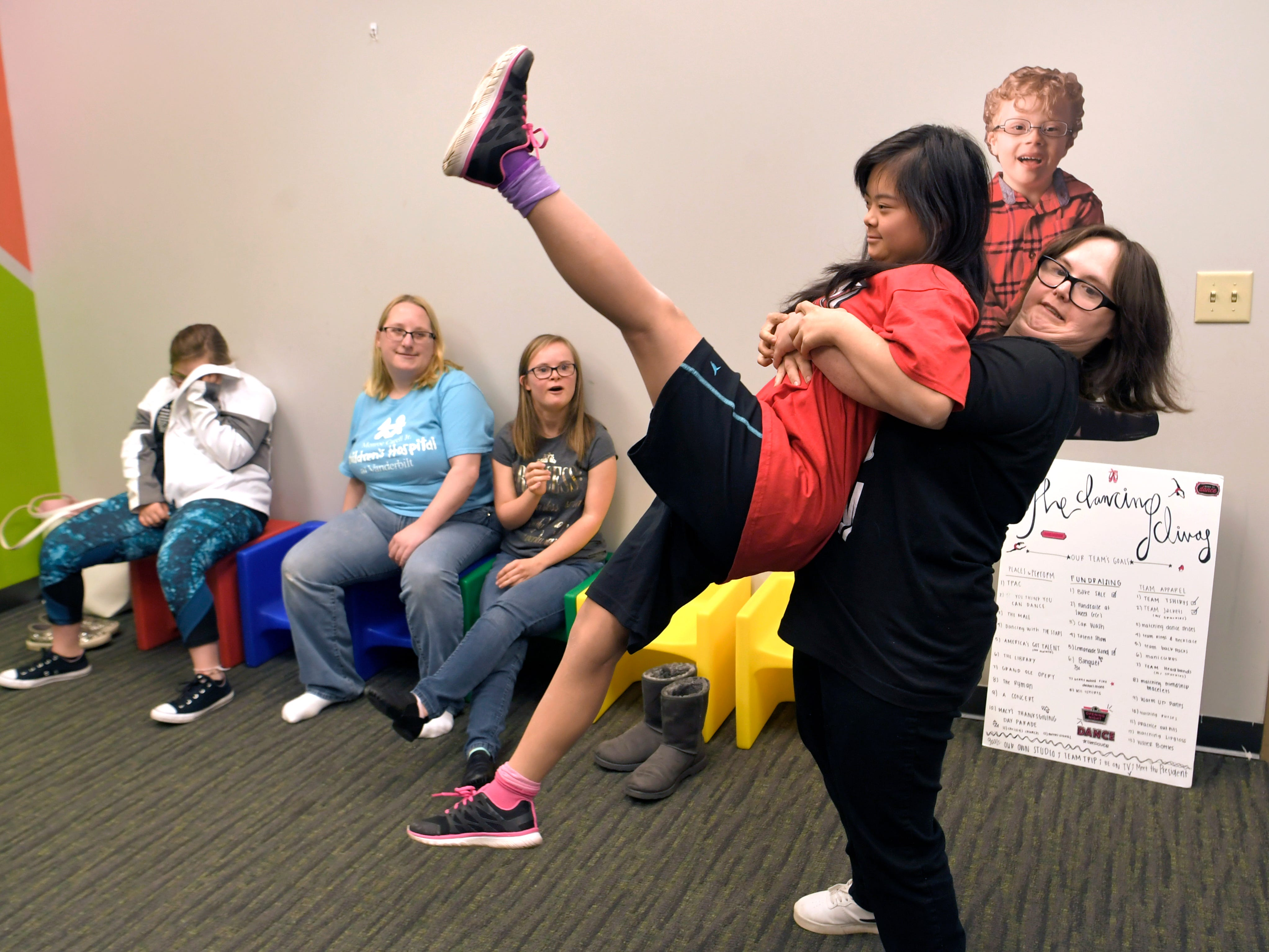Sisters and Dancing Divas members  Tori and Laney Hammett show off a dance routine during dance team practice at GiGi's Playhouse in Brentwood on Saturday, Jan. 12, 2019.  The Dancing Divas is a special needs dance team based in Brentwood