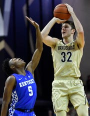 Vanderbilt forward Matt Ryan (32) shoots over Kentucky guard Immanuel Quickley (5) during the second half at Memorial Gym Tuesday Jan. 29, 2019 in Nashville, Tenn.