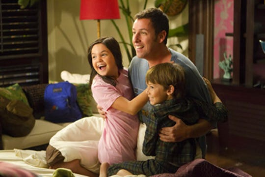 "In this film publicity image released by Columbia Pictures, from left, Bailee Madison, Adam Sandler and Griffin Gluck are shown in a scene from ""Just Go with It"" from 2011."
