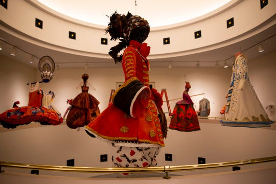 Paper costumes by Isabelle de Borchgrave hang from the ceiling at Artis-Naples in Naples, on Wednesday, January 30, 2019.