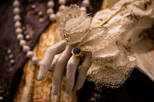 Jewelry and ruffles, also made of paper, adorn a costume by Isabelle de Borchgrave at Artis-Naples in Naples, on Wednesday, January 30, 2019.