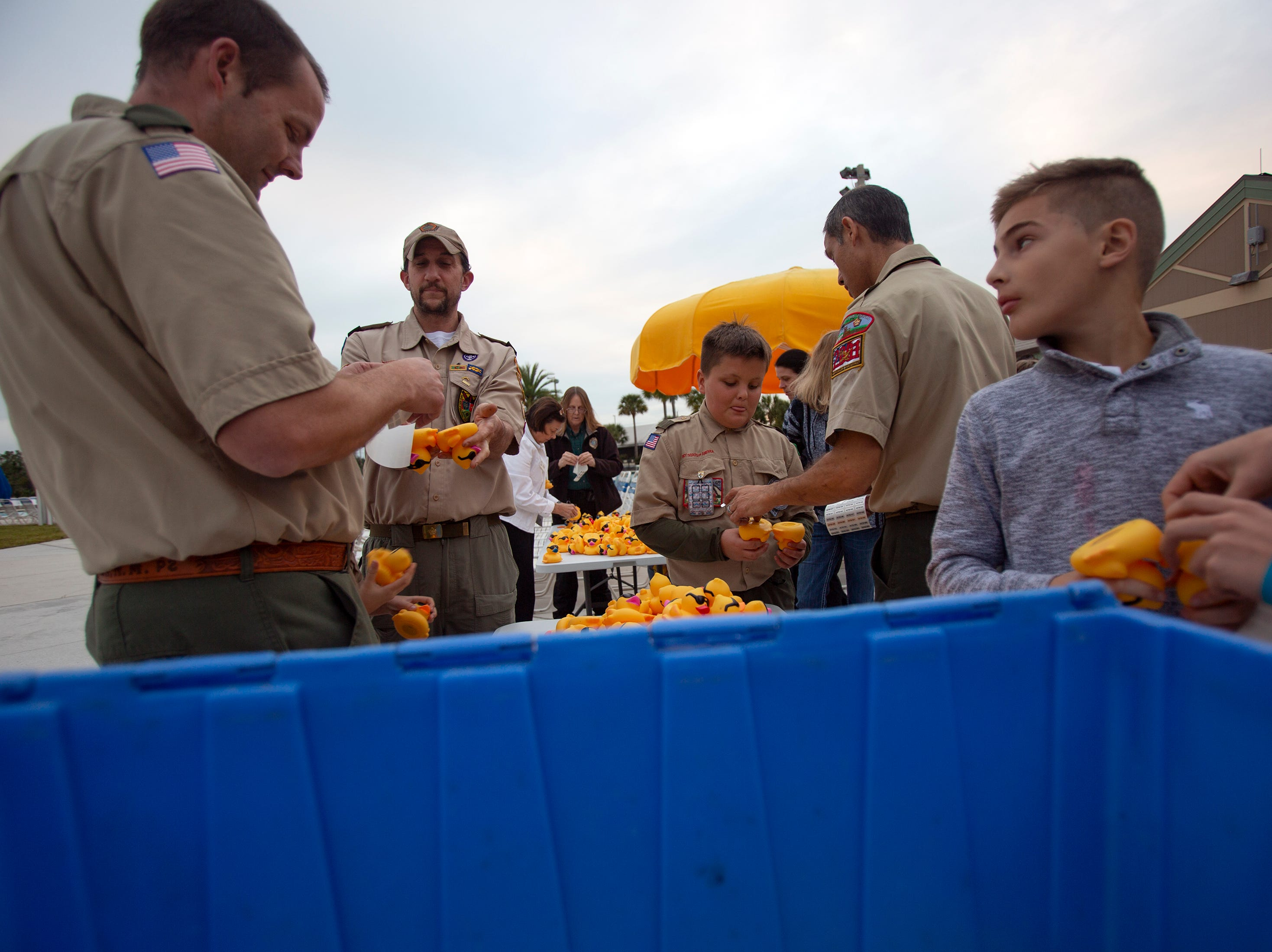 Members of Boy Scout Troop 2001 place tags on rubber ducks, Wednesday, Jan. 30, 2019, at the North Collier Regional Park in East Naples.