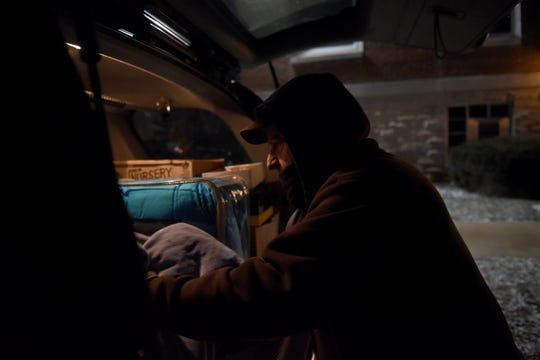 Craig Goodwin unloads blankets, coats, and other donations from his car to give to Central Christian Church during the polar vortex on Tuesday night. The Newark church opened its doors as a temporary shelter for those in need of a warm place to sleep. The church will also be opened Wednesday night starting at 4 p.m. with doors closing at 9 p.m. for those staying overnight. The warming Center will end at 9 a.m. on Thursday.