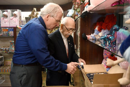 """It's the best job I've ever had,"" says Herand Kafafian, 100, of the fifteen years he has been volunteering in the gift shop at Holy Name Medical Center in Teaneck. Gift shop manager Patrick Finnegan shows a product number to Kafafian so he can price the item on Monday, January 28, 2019."