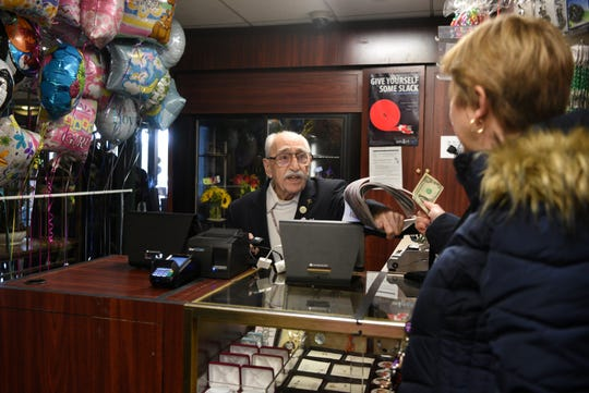 """It's the best job I've ever had,"" says Herand Kafafian, 100, of the fifteen years he has been volunteering in the gift shop at Holy Name Medical Center in Teaneck. Kafafian helps customer Virginia Baldassari of Norwood on Monday, January 28, 2019."