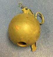 A golden grenade confiscated at Newark Airport