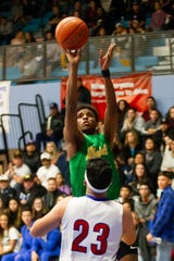 Mayfield's Jorell Satterfield shoots a jump shot over Las Cruces High's Salvador Nevarez during boys prep basketball on Tuesday at LCHS.
