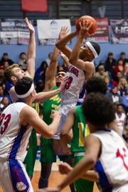 Las Cruces High's Ray Brown powers up a jump shot against Mayfield defenders on Tuesday at LCHS.